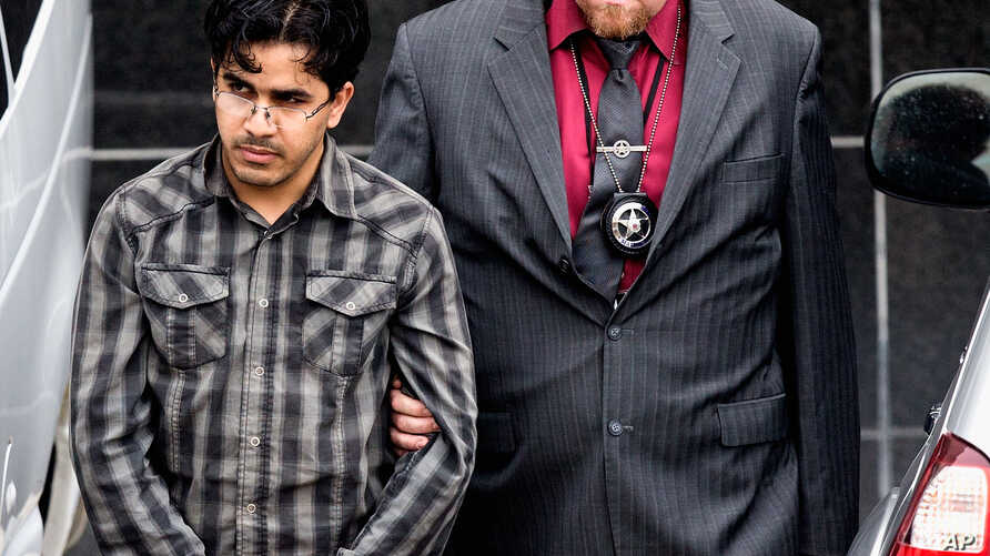 FILE - Omar Faraj Saeed Al Hardan, left, is escorted by U.S. Marshals from the Bob Casey Federal Courthouse, in Houston, Jan. 8, 2016.