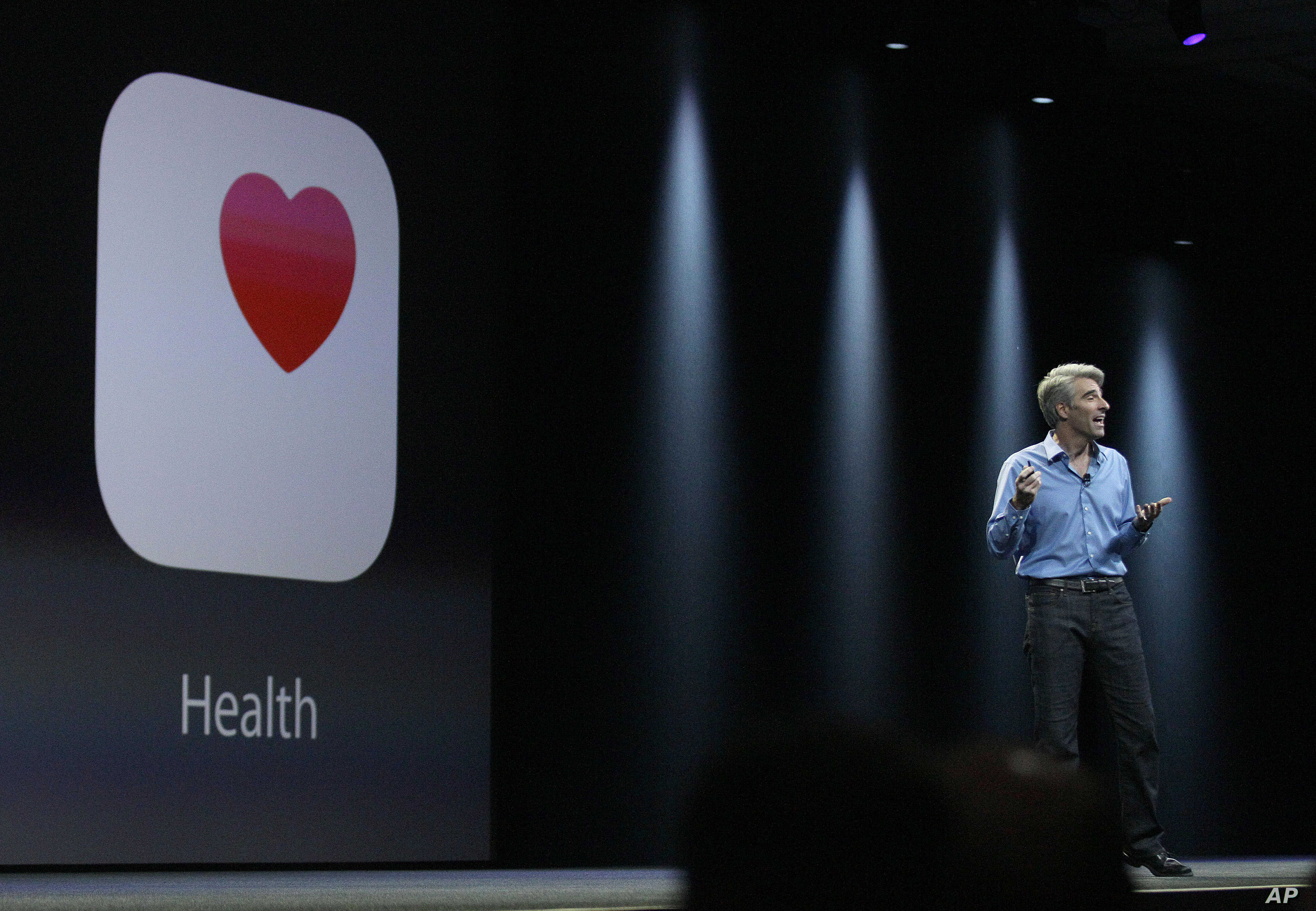FILE - Apple senior vice president of Software Engineering Craig Federighi speaks about the Apple HealthKit app at the Apple Worldwide Developers Conference in San Francisco.