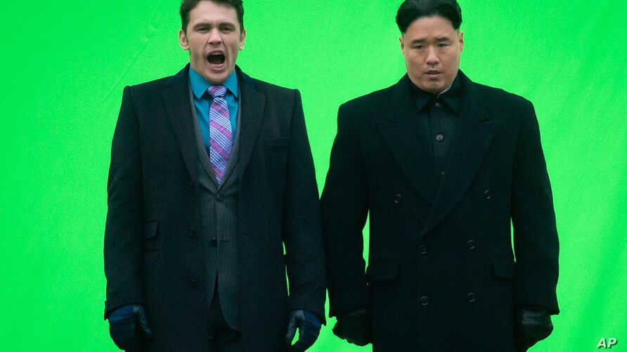 "FILE - Actor James Franc (L) yawns before filming a scene with an actor playing North Korean leader Kim Jong Un for the movie ""The Interview,"" at Robson Square in Vancouver, British Columbia."
