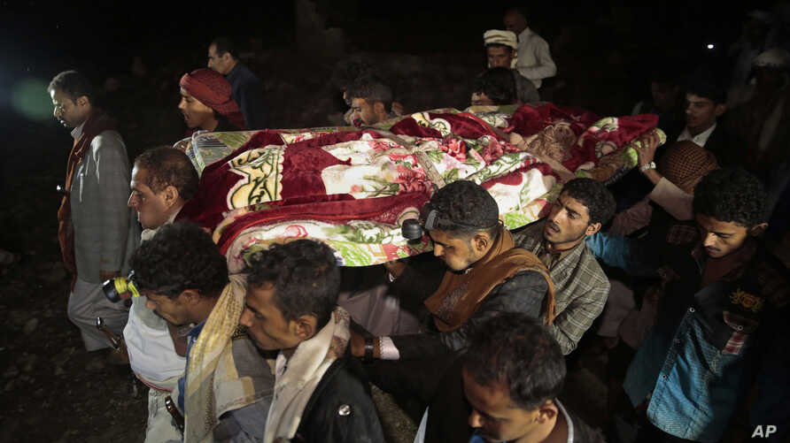 FILE - Mourners carry the body of Youssef al-Salmi, 10, who was killed when a bomb exploded while he was playing with it near his family's house in Hasn Faj Attan village, in the mountainous outskirts of Sanaa, Yemen.