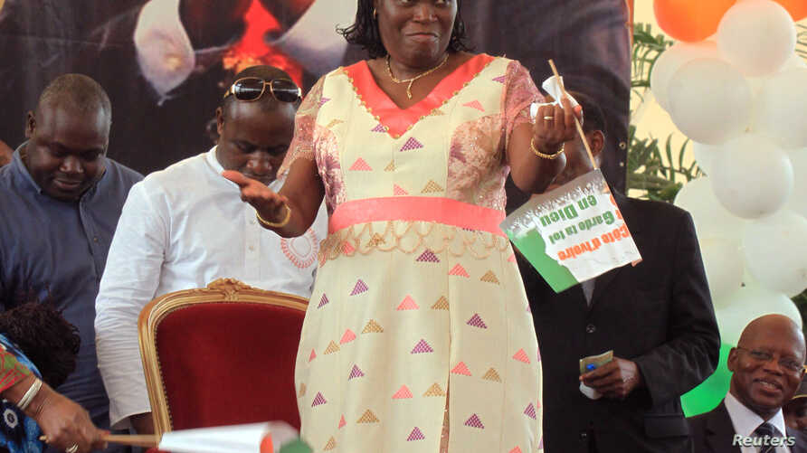 Simone Ehivet Gbagbo, wife of Laurent Gbagbo, attends a rally at the Culture Palace in Abidjan, January 15, 2011.