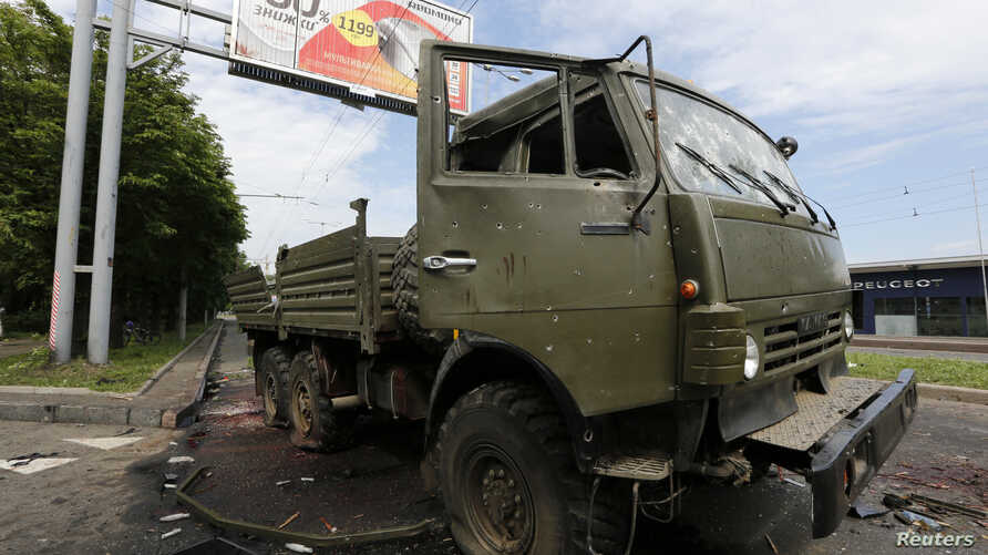 A wrecked Kamaz truck is seen near the Donetsk airport, Ukraine, May 27, 2014.