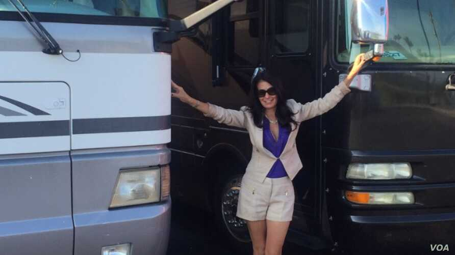 Gigi Stetler with one of her many RVs, at Planet RV in Florida, October, 2015 (Courtesy of Niamh)
