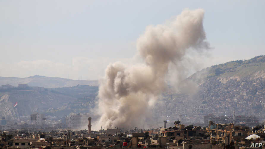 Smoke billows following a reported air strike in the rebel-held parts of the Jobar district, on the eastern outskirts of the Syrian capital Damascus, March 19, 2017.