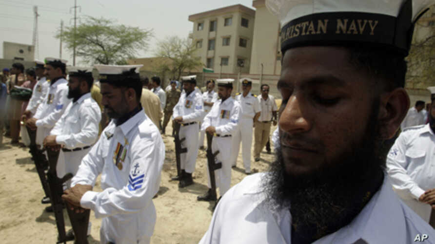 Pakistai Navy officers pay tribute to their colleague who was killed during a militant seige on a Karachi naval base at a funeral in Lahore, Pakistan, May 23, 2011.