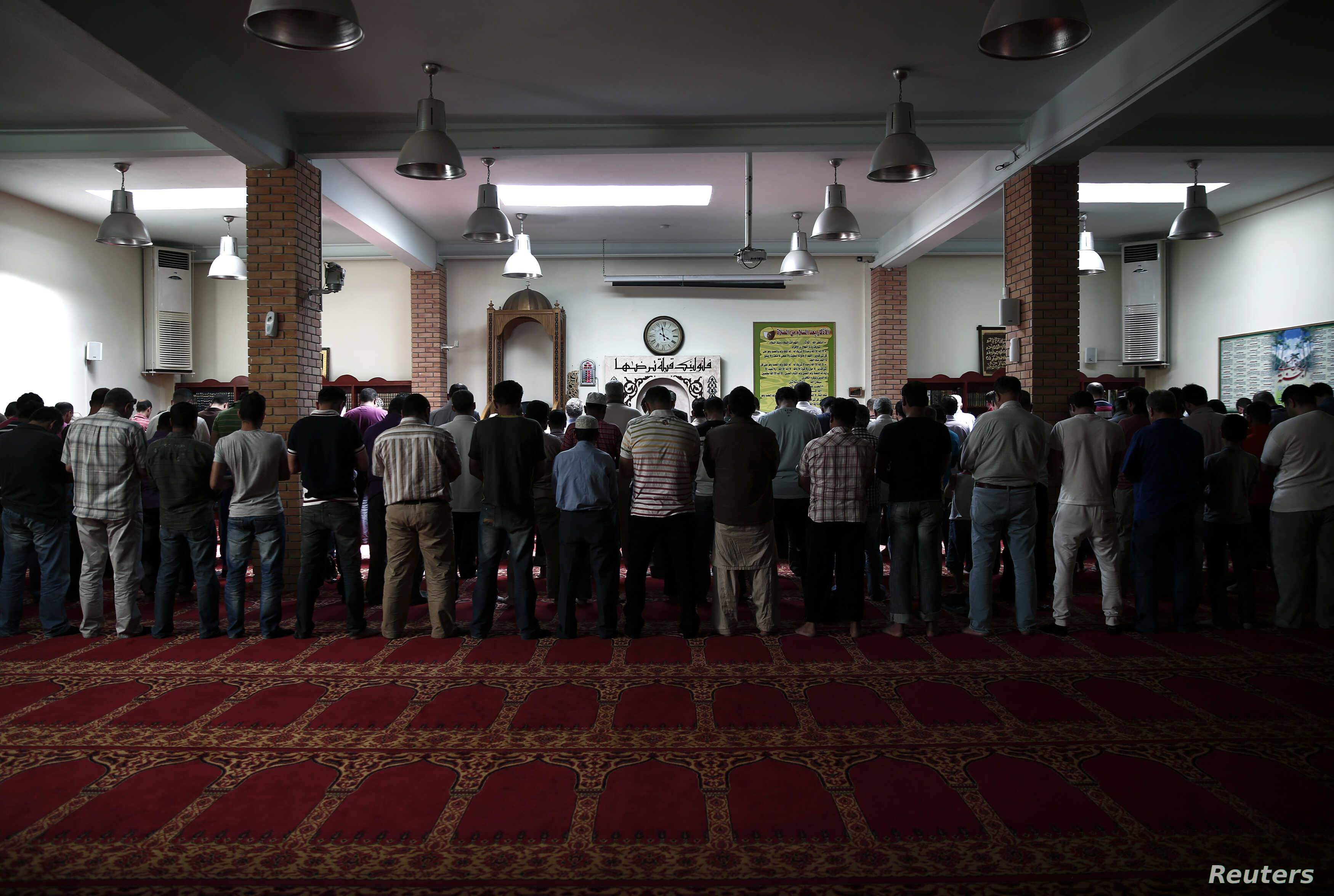 Muslims pray inside the Greek-Arabic educational cultural center at Moschato suburb in Athens May 24, 2013.