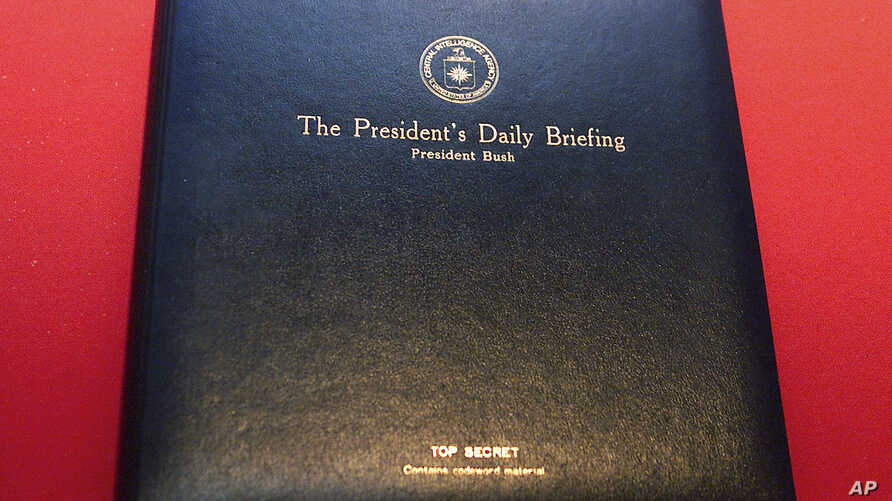 """FILE - The President's Daily Briefing """"PDB,"""" a top secret leather binder, in which President Bush receives his daily intelligence reports is displayed at the """"Spies: Secrets from CIA, KGB, and Hollywood"""" exhibit at the Ronald Reagan Presidential Libr"""