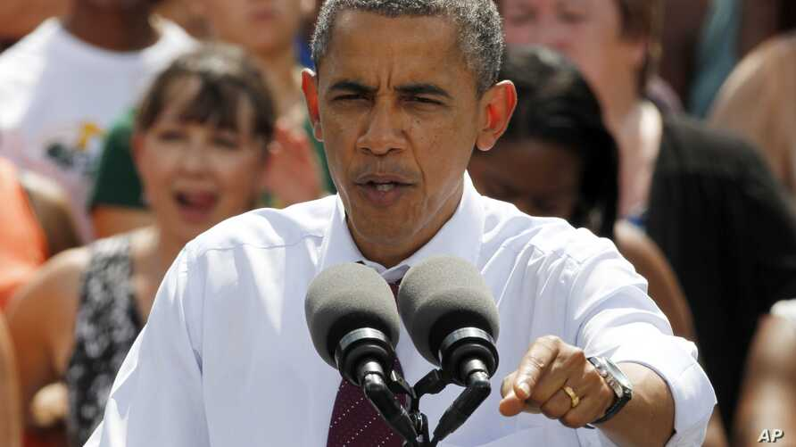 President Barack Obama gestures during a rally at Norfolk State University in Norfolk, Virginia, Tuesday, Sept. 4, 2012.