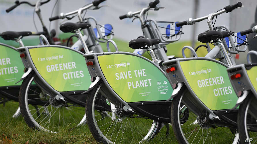 "Bicycles reading ""save the planet"" wait for customers at the COP 23 Fiji UN Climate Change Conference in Bonn, Germany, Nov. 6, 2017."