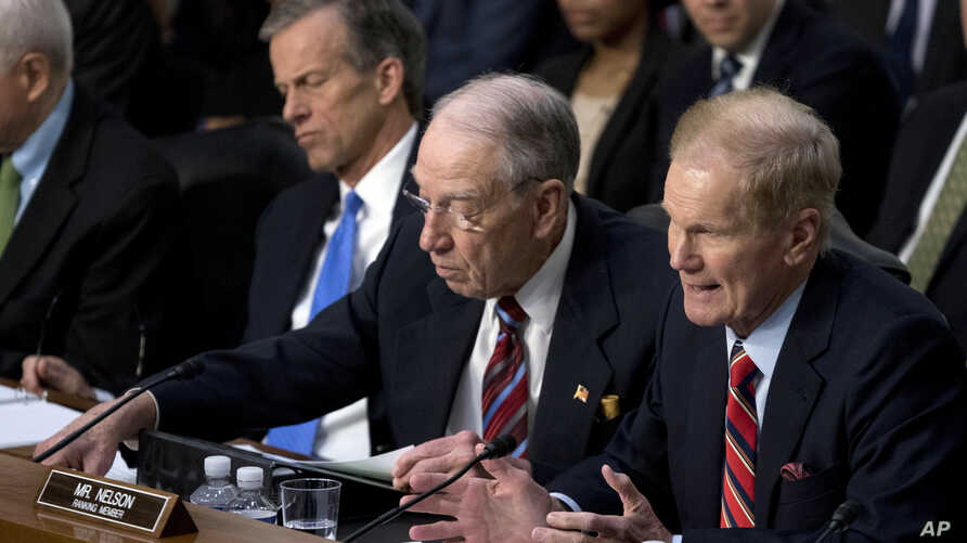 Sen. Bill Nelson, D-Fla., right, accompanied by Sen. John Thune, R-S.D., left, and Sen. Chuck Grassley, R-Iowa, second from left, speaks as Facebook CEO Mark Zuckerberg testifies before a joint hearing of the Commerce and Judiciary committees on Capi