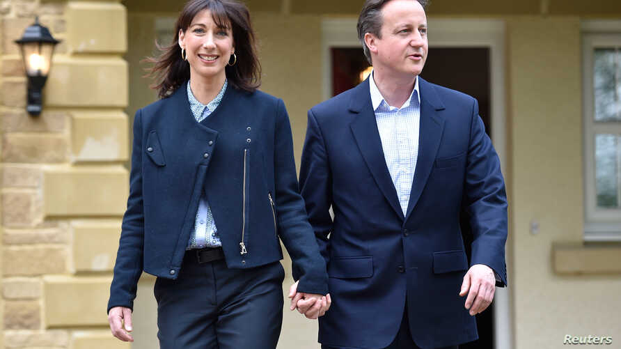 Britain's Prime Minister David Cameron is joined by his wife Samantha during a campaign visit to a home building scheme in Lancaster, northern England, May 6, 2015.