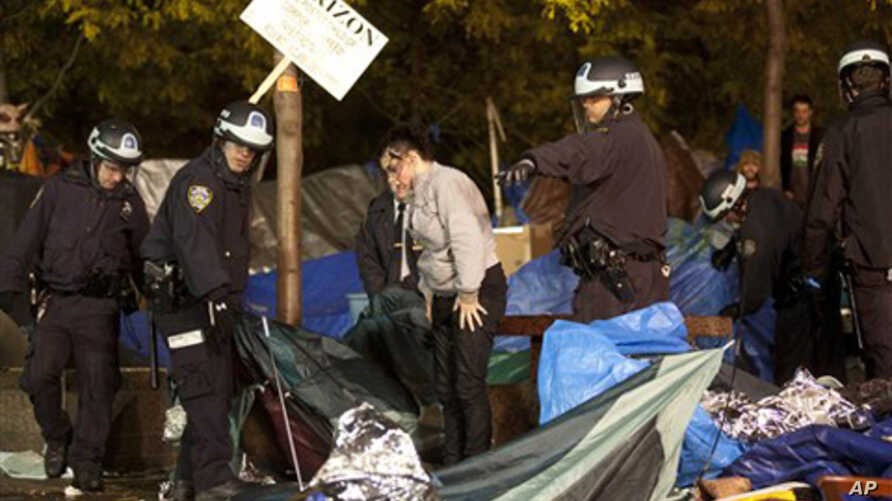Police officers order Occupy Wall Street protesters to leave Zuccotti Park, their longtime encampment in New York, November 15, 2011.