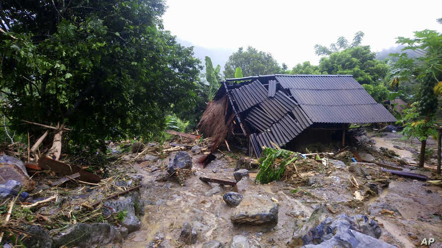 Flash floods damage a house in northern province of Hoa Binh, Vietnam, Oct. 13, 2017. Floods and landslides have killed dozens of people in Vietnam since a tropical depression hit the country earlier this week, in one of its worst natural disasters i