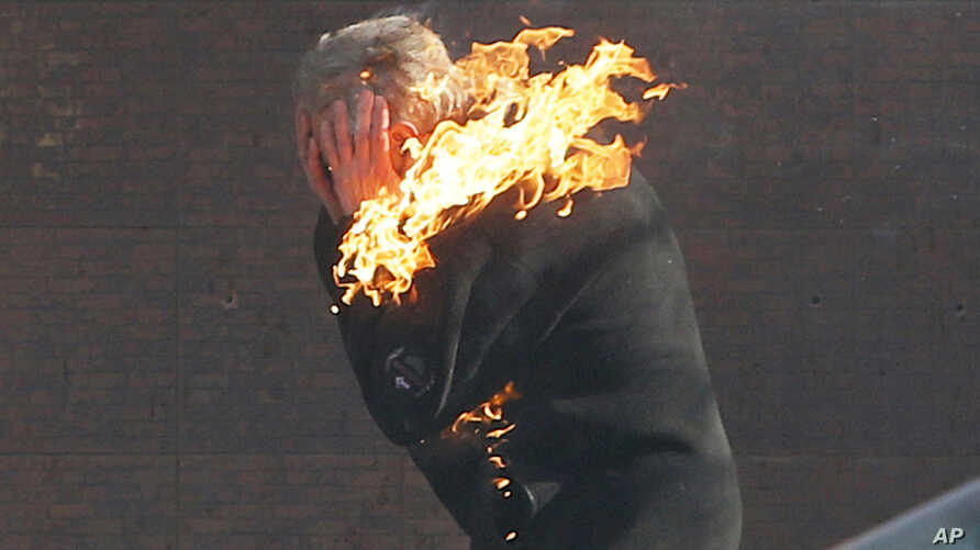 An anti-government protester is engulfed in flames during clashes with riot police outside Ukraine's parliament in Kyiv, Ukraine, Feb. 18, 2014.