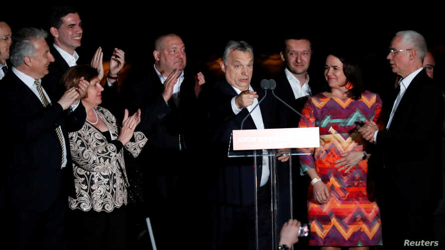 Hungarian Prime Minister Viktor Orban addresses supporters after the announcement of the partial results of parliamentary election in Budapest, April 8, 2018.