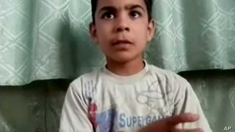 Image made from amateur video released by the Houla Media Office and accessed May 31, 2012 purports to show 11-year-old Ali el-Sayed, a survivor of the Houla massacre.