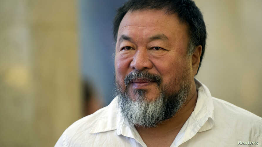 Dissident Chinese artist Ai Weiwei arrives at the town hall in Berlin, Germany, Aug. 13, 2015.