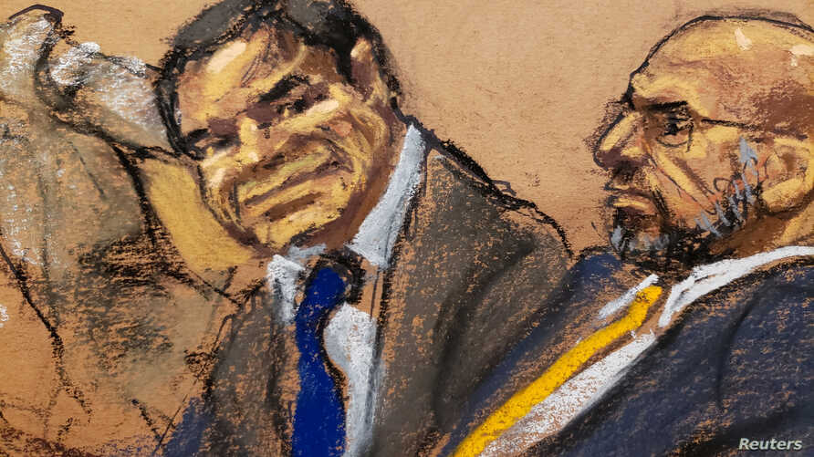 """Accused Mexican drug lord Joaquin """"El Chapo"""" Guzman and defense attorney A. Eduardo Balarezo, sit in court in this courtroom sketch during Guzman's trial in Brooklyn federal court in New York City, Jan. 30, 2019."""
