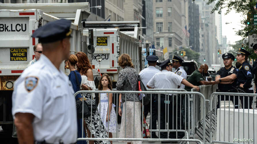 Pedestrians navigate their way through barricades amid heightened security before the start of the United Nations General Assembly in New York City,  Sept.  17, 2017.