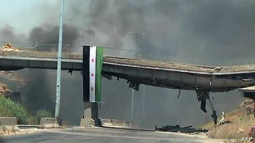 An image grab taken from a video released by the United Nations Supervision Mission in Syria (UNSMIS) shows smoke rising following shelling from the central flashpoint city of Homs on June 11, 2012.