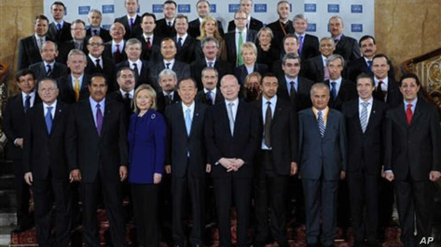 Delegates attending the London Conference on Libya, pose for a group photo at Lancaster House in London, Tuesday March 29, 2011.
