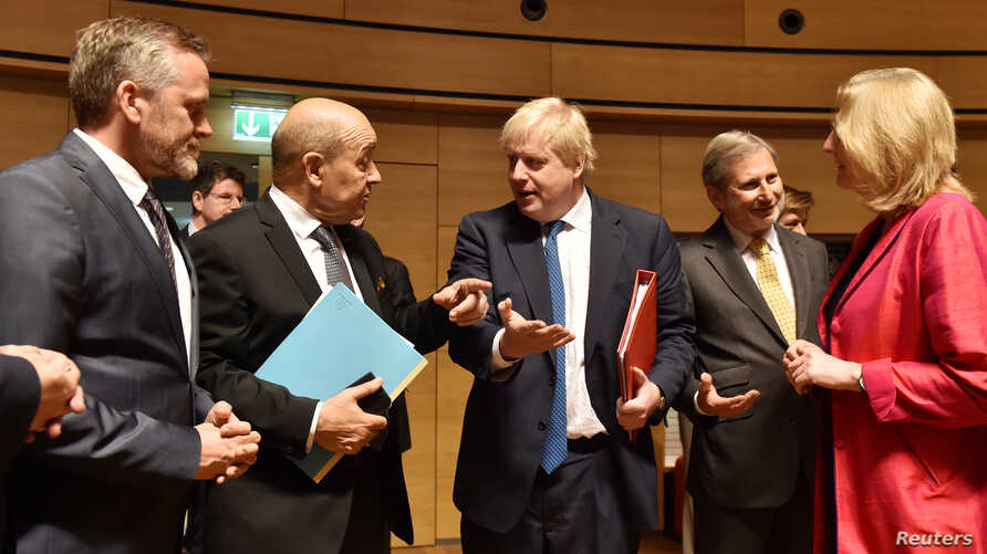 Danish Foreign Minister Anders Samuelsen and French Minister for Foreign Affairs Jean-Yves Le Drian talk with Britain's Foreign Secretary Boris Johnson, European commissioner Johannes Hahn and Austrian Foreign Minister Karin Kneissl during an EU fore