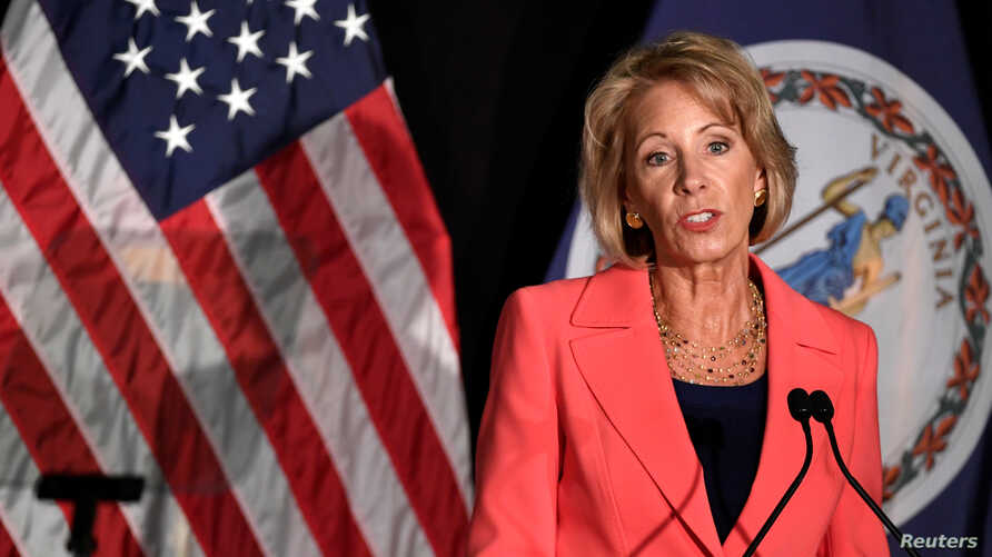 FILE - Education Secretary Betsy DeVos makes remarks during a major policy address on Title IX enforcement, which in college covers sexual harassment, rape and assault, at George Mason University, in Arlington, Virginia, Sept. 7, 2017.