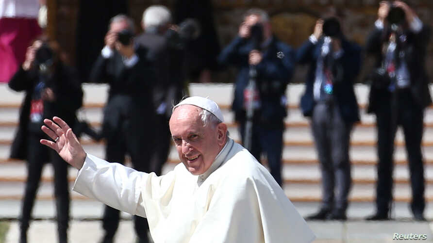 Pope Francis waves as he leaves at the end of a Holy Mass to mark the feast of Divine Mercy at the Vatican, April 8, 2018.
