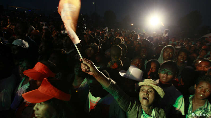 Supporters of Madagascar's presidential candidate Edgard Razafindravahy attend his final campaign rally in the capital Antananarivo, October 23, 2013.