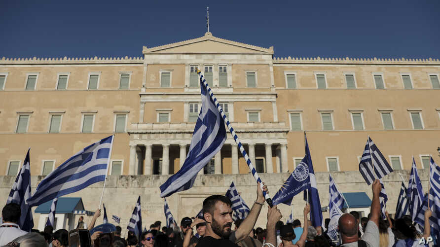 FILE - Protesters take part in a rally opposing Greece's name deal with neighboring Macedonia in Athens, Greece, on July 1, 2018.