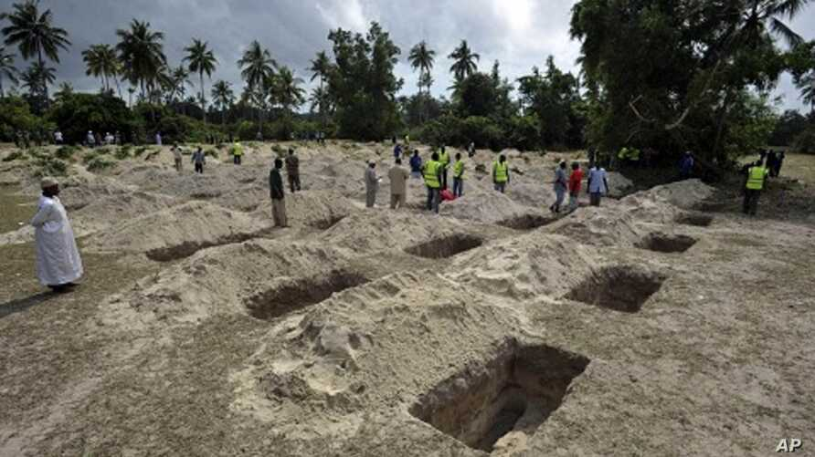 Graves are dug for victims of a ship which sank early Saturday near the island of Zanzibar, Tanzania, September 11, 2011.