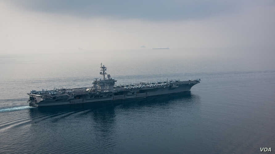 The aircraft carrier USS Carl Vinson (CVN 70) transits the Sunda Strait. The Carl Vinson Carrier Strike Group is on a regularly scheduled Western Pacific deployment as part of the U.S. Pacific Fleet-led initiative to extend the command and control f