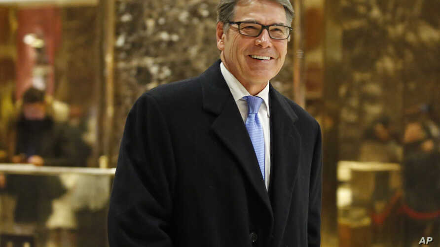 Former Texas Gov. Rick Perry smiles as he leaves Trump Tower in New York, Dec. 12, 2016. Aides said President-elect Donald Trump had decided to name Perry to head the U.S. Department of Energy.