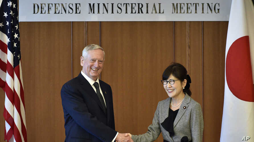U.S. Defense Secretary Jim Mattis, left, and Japanese Defense Minister Tomomi Inada pose for a photo prior to their meeting at Defense Ministry in Tokyo, Feb. 4, 2017.
