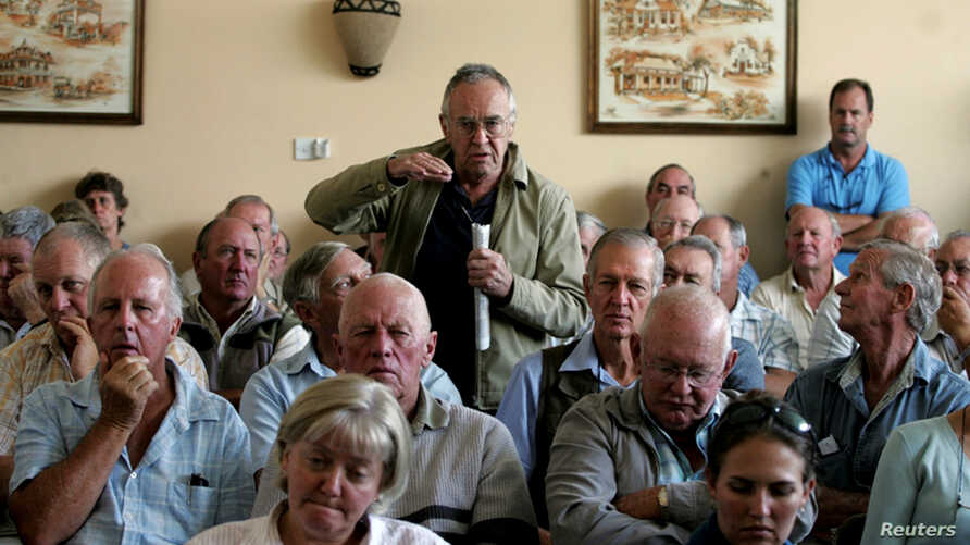 FILE - A farmer addresses a meeting of white commercial farmers in Harare, Zimbabwe, Feb. 5, 2010.