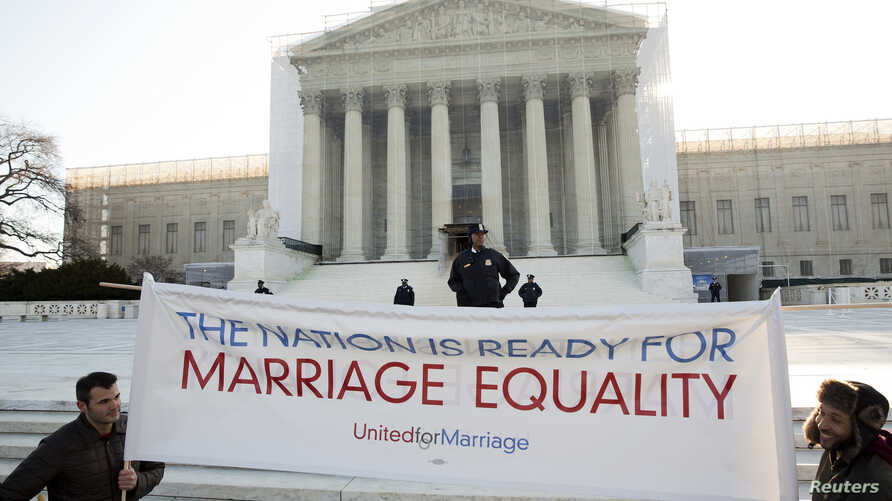 Supporters of gay marriage hold a banner as they rally in front of the Supreme Court in Washington March 27, 2013. For the second day running, the Supreme Court convened on Wednesday to tackle the issue of gay marriage, this time to hear arguments ov