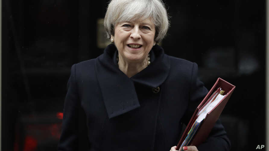 British Prime Minister Theresa May leaves 10 Downing Street in London, Feb. 1, 2017.