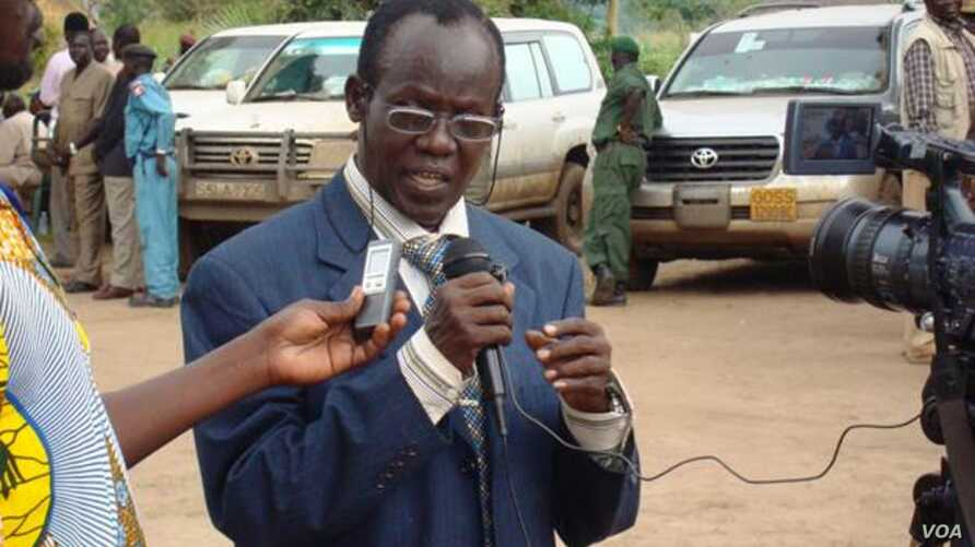 Newly approved South Sudanese Vice President James Wani Igga speaks to reporters.