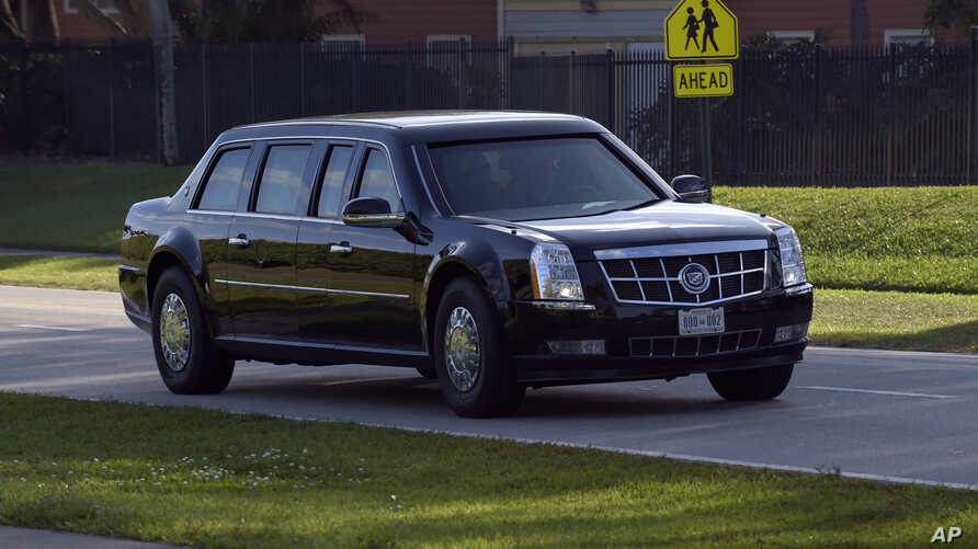 FILE - The limousine carrying President Donald Trump leaves the Trump International Golf Club in West Palm Beach, Fla., Feb. 11, 2017.