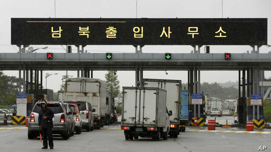 South Korean vehicles leave for South and North Korea's joint Kaesong Industrial Complex to bring back their finished goods and materials at the customs, immigration and quarantine office of the Inter-Korean Transit Office near the border village of