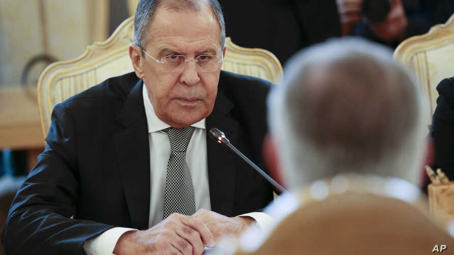 Russian Foreign Minister Sergey Lavrov listens to U.S. Secretary of State Rex Tillerson, right back to the camera, during their talks in Moscow, Russia, April 12, 2017.