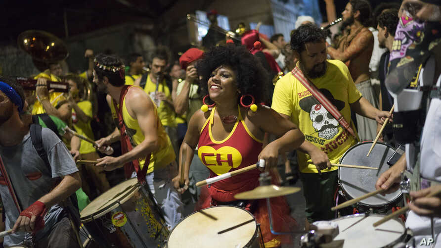 "A woman sporting a Chapulin Colorado costume, from the Mexican television series, drums during the ""Chroma Aqui na Minha Mao"" street party in Rio de Janeiro, Brazil, Feb 8, 2018."