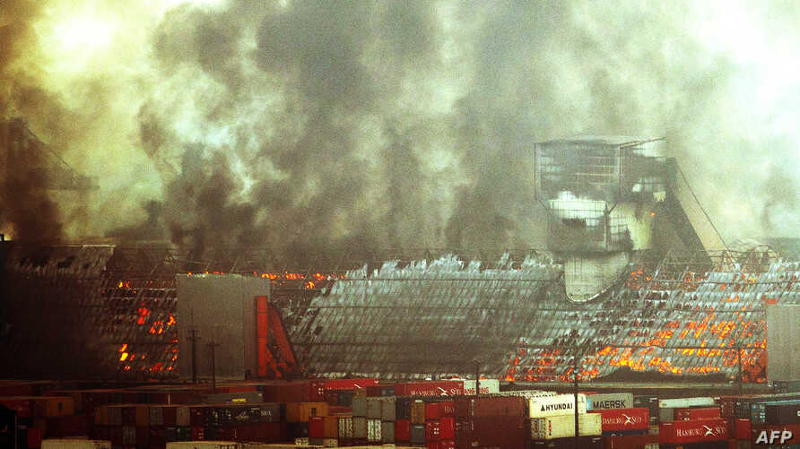 Four warehouses with sugar burn in flames at the port of Santos, the biggest of Latin America, some 60 km of Sao Paulo, Brazil, Oct.18, 2013.
