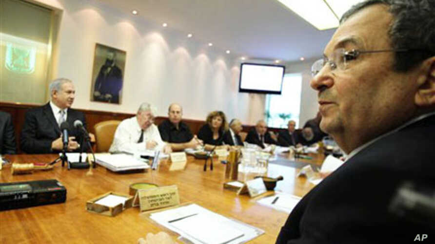 """Israeli Prime Minister Benjamin Netanyahu, left, and Israeli Defense Minister Ehud Barak, front right, at a cabinet meeting that approved a controversial bill requiring new citizens to pledge allegiance to a """"Jewish and democratic"""" state. Jerusalem,"""