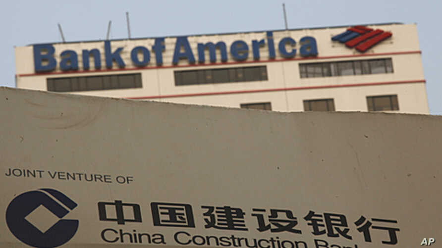 A construction site of the Hong Kong headquarters of China Construction Bank (Asia) is seen in front of Bank of America Tower at Hong Kong's financial Central district, August 25, 2011
