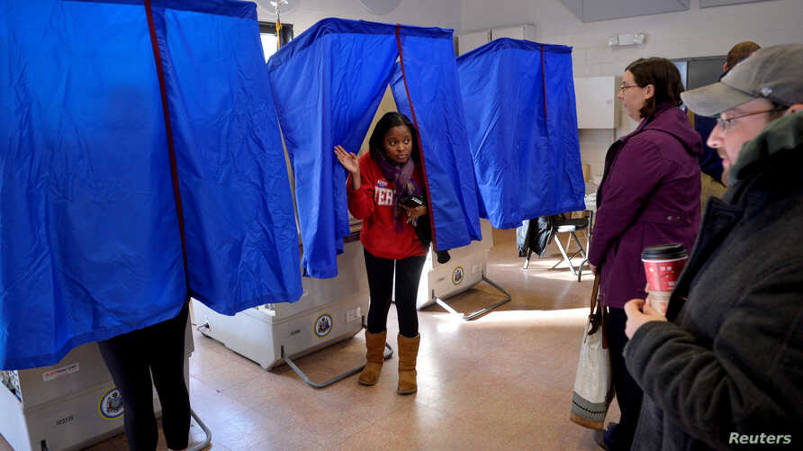 FILE - A voter leaves the polling booth during the U.S. presidential election in Philadelphia,  Nov. 8, 2016.