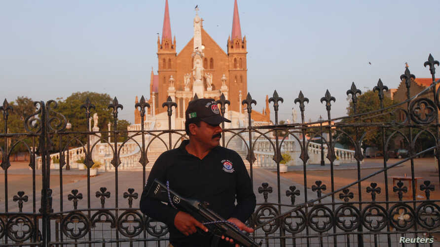 A police officer stands guard outside St. Patrick's Cathedral ahead of the Christmas celebrations in Karachi, Pakistan, Dec. 20, 2017. Many Christians are celebrating Christmas under increased security.