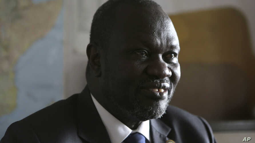 FILE - South Sudan rebel leader Riek Machar speaks in an interview with The Associated Press in Johannesburg, South Africa, Oct. 20, 2016.