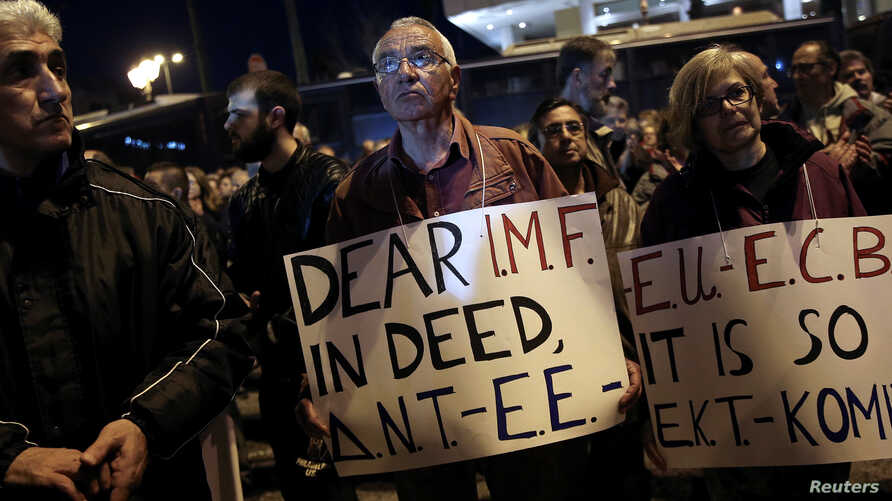 FILE - Members of the communist-affiliated PAME trade union take part in a demonstration outside a hotel, where members of the Greek government meet with representatives of the country's international lenders, in Athens, Greece, March 1, 2017.