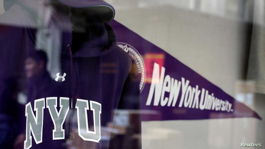 FILE - A sweatshirt and pennant are seen inside the bookstore at New York University in New York.